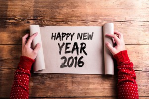 Hands holding scroll with Happy New Year 2016 message